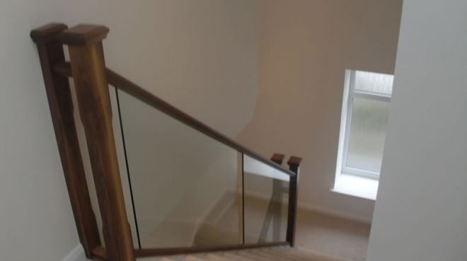 Glass panel staircase